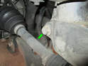 Left and right sides of car - Loosen and remove the 15mm bolt at the rear of the wheel carrier (green arrow).
