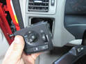 Once free, pull the switch out of the dashboard and turn it over to access the electrical connection.