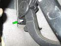 Shown here is the lower 10mm nut (green arrow) that holds the accelerator pedal module to the firewall.