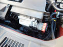 Shown here is the Volvo DME, located next to the air filter under a plastic cover in the engine compartment.