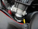 Pull the intake hose off the bottom of the throttle body.