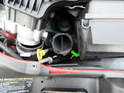 Pull the elbow piece (green arrow) out of the airbox.