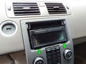 Now use the plastic pry bar to carefully pry out the display panel for the stereo along the bottom edge (green arrows).