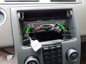 Loosen and remove the two T25 Torx screws (green arrows) holding the top of the waterfall console to the dashboard.