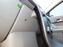 Now move to behind the waterfall console and pry off the upper trim panel (green arrow).