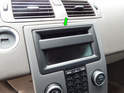 Begin by prying out the plastic surround on the waterfall console along the top edge (green arrow).