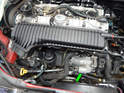 Replacing the starter motor (green arrow) on the Volvo C30 requires you to first remove the air filter housing for access.