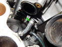 You'll now need to cut off the hose clamp (green arrow) off the vacuum hose and pull the hose off the upper plenum.