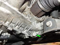 Now locate the drain plug (green arrow) at the bottom of the transmission case.