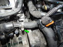 Return to the thermostat housing and locate the hose to the right.
