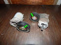 Now use the T50 driver to remove each bolt (green arrows) and remove the pulleys from the tensioners.