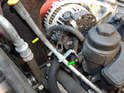 You'll need to move the oil dipstick (yellow arrow) out of the way in order to remove the alternator from the engine bay.