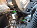 Now loosen and remove the two lower 10mm bolts (green arrows) holding the alternator to the engine block.
