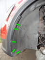 Left and Right Sides: Loosen and remove the five T25 Torx screws (green arrows) along the front edge of the wheel liner.