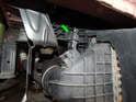 Move to the right side of the car and locate the boost pressure sensor on the top of the intercooler.