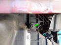 Loosen and remove the T30 Torx screw (green arrow) holding the right side of the intercooler to the radiator support frame.