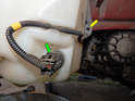 Now locate the electrical connector for the fluid level sensor.