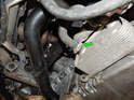 Now move to the rear of the oil pan and locate the oil cooler.