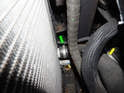 Follow the lower radiator hose (yellow arrow) down to the connection at the radiator.