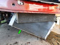 Once the radiator frame is removed, carefully lower the radiator (green arrow) out from below.