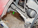 Left and Right sides: Here is the control arm mounted to the car (green arrow).