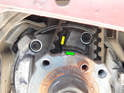 Thread the 30mm nut back onto the mounting flange and rotate the engine clockwise until you see the notch cast into the face (green arrow) line up with the edge of the casting rib (yellow arrow) on the engine block.