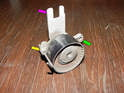 Shown here is the timing belt tensioner removed from the engine for purposes of clarity.