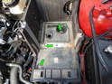 Loosen and remove the three 8mm bolts (green arrows) holding the battery box to the transmission mount.