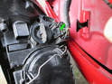 Both sides of car: Turn the headlight assembly over to access the electrical connection.