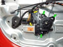 Left and right Sides of car: Shown here is a close up of the power window motor.
