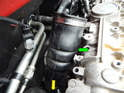 You'll now need to remove the upper intake hose (green arrow) leading to the turbo.