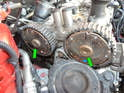 Loosen and remove the T55 Torx plugs (green arrows) in the center of each VVT unit.