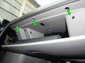 Loosen and remove the three T25 Torx screws (green arrows) at the top edge of the glove box.