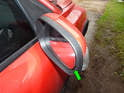 Use a long screwdriver in between the mirror housing and the glass (green arrow) to carefully pry the glass off the motor assembly.