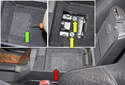 Open the storage compartment and remove the plastic cover at the bottom (red arrow).