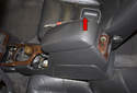 Slide the center console toward the rear of the vehicle.