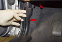 Front trim: Start at the A-pillar and detach the trim piece by pushing it toward the center of the vehicle (red arrow).