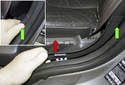 Front trim: Working at the B-pillar, detach the trim piece by pushing it toward the center of the vehicle (red arrow).