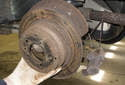 Remove the rear brake rotor on the side of the vehicle you are replacing the wheel bearing on.