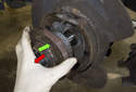 With the fastener (nut) removed, slide the bearing with flange off the spindle (red arrow).