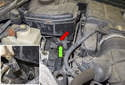 Front sensor: Working in the engine compartment, disconnect the electrical connector by pressing the release tab (green arrow) and sliding the sensor side connector out of the housing (inset).