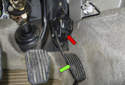 The accelerator pedal sensor (red arrow) is permanently attached to the accelerator pedal (green arrow).
