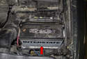 Replacing battery: Keep your battery (red arrow) and battery terminals clean.