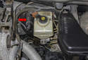 The brake pedal position switch is mounted in the right side of the brake booster (red arrow).