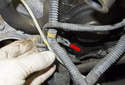 Remove the mount from the wiring harness by opening it and pulling the wiring harnesses out of it.