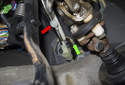 To remove the clutch switch from the clutch master cylinder, pull the top (red arrow) down.