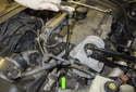 Use a long extension and a 10mm socket, remove the crankshaft sensor fastener (green arrow).