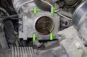 Working at the throttle housing, remove the four 10mm fasteners (green arrows).