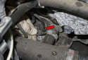 Once the fastener is removed, check that the sensor is free by moving it side to side (red arrow).