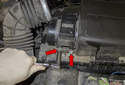 Working at the mass air flow sensor, remove the two 10mm fasteners (red arrow).